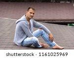 barefoot attractive young boy...   Shutterstock . vector #1161025969