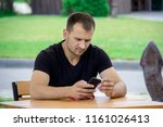 man with smartphone reading...   Shutterstock . vector #1161026413