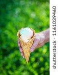 ice cream cone in hands | Shutterstock . vector #1161039460