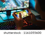 portrait of teenage gamer boy... | Shutterstock . vector #1161055600