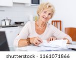 senior woman sitting and... | Shutterstock . vector #1161071866