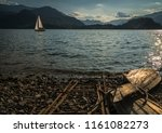 solitary boat wood destroyed... | Shutterstock . vector #1161082273