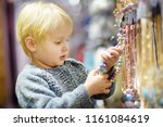 cute little boy helps his mom... | Shutterstock . vector #1161084619