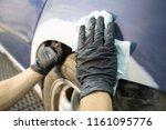 auto repairman plastering... | Shutterstock . vector #1161095776