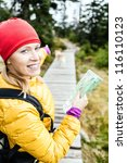 Stock photo happy woman hiking and reading map in forest hiker with dog karkonosze mountains in poland young 116110123