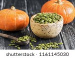 Bowl With Raw Pumpkin Seeds On...