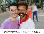 interracial gay couple outdoor... | Shutterstock . vector #1161145339