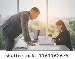 female architect is showing her ... | Shutterstock . vector #1161162679