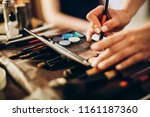 hands holding brush and... | Shutterstock . vector #1161187360