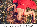 beautiful young woman lying on... | Shutterstock . vector #116122660