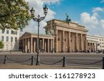 Small photo of The Branderburg gate (Branderburger Tor) - famous historical monument in Berlin, Germany. View from the west side.