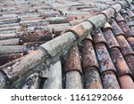 tiled shingles roof of an old... | Shutterstock . vector #1161292066