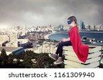 superhero kid sitting on a... | Shutterstock . vector #1161309940