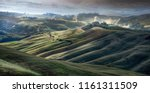 the rolling hills of tuscany | Shutterstock . vector #1161311509