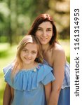 happy mother and daughter... | Shutterstock . vector #1161314953