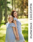 happy mother and daughter... | Shutterstock . vector #1161314956