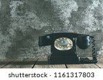 a old phone on the wood | Shutterstock . vector #1161317803