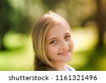 beautiful young girl enjoying... | Shutterstock . vector #1161321496
