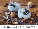 blueberries and yogurt chia...   Shutterstock . vector #1161344239