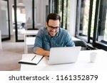 cheerful businessman using... | Shutterstock . vector #1161352879