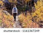woman tourist walking on trail... | Shutterstock . vector #1161367249