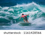 riding the waves. costa rica ... | Shutterstock . vector #1161428566