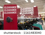 Red clearance sale sign in...