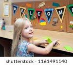 smart happy girl cutting the... | Shutterstock . vector #1161491140