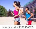 running couple. runners jogging ...   Shutterstock . vector #1161506620