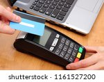 paying with contactless credit... | Shutterstock . vector #1161527200