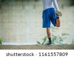 young man stretches before his... | Shutterstock . vector #1161557809