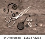 old scissors and buttons on the ...   Shutterstock . vector #1161573286