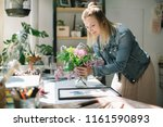 happy florist making a bouquet... | Shutterstock . vector #1161590893