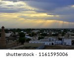 clouds and sun over khiva ... | Shutterstock . vector #1161595006