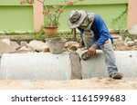 worker stoppers the leak of... | Shutterstock . vector #1161599683