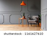 orange lamp above table with...   Shutterstock . vector #1161627610