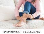 Closeup Woman Sitting On Sofa...