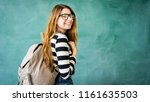 happy student with backpack on... | Shutterstock . vector #1161635503