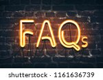 faqs neon sign on dark brick... | Shutterstock . vector #1161636739
