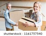 happy senior couple holding... | Shutterstock . vector #1161757540