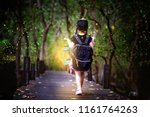 Little Girl Holding Lamp Light...