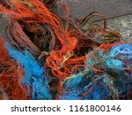torn orange and blue ropes from ...   Shutterstock . vector #1161800146