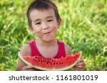 happy asian child eating... | Shutterstock . vector #1161801019
