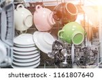 open dishwasher with clean... | Shutterstock . vector #1161807640