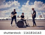 rock band in black clothing... | Shutterstock . vector #1161816163