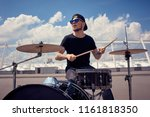 Young Tattooed Drummer In...