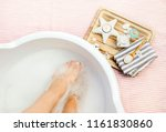 taking magnesium foot bath for... | Shutterstock . vector #1161830860
