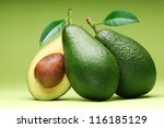 avocado isolated on a green... | Shutterstock . vector #116185129