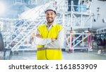 Stock photo portrait of aircraft maintenance mechanic in safety vest 1161853909