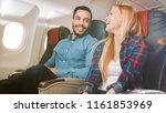 on a commercial plane flight... | Shutterstock . vector #1161853969